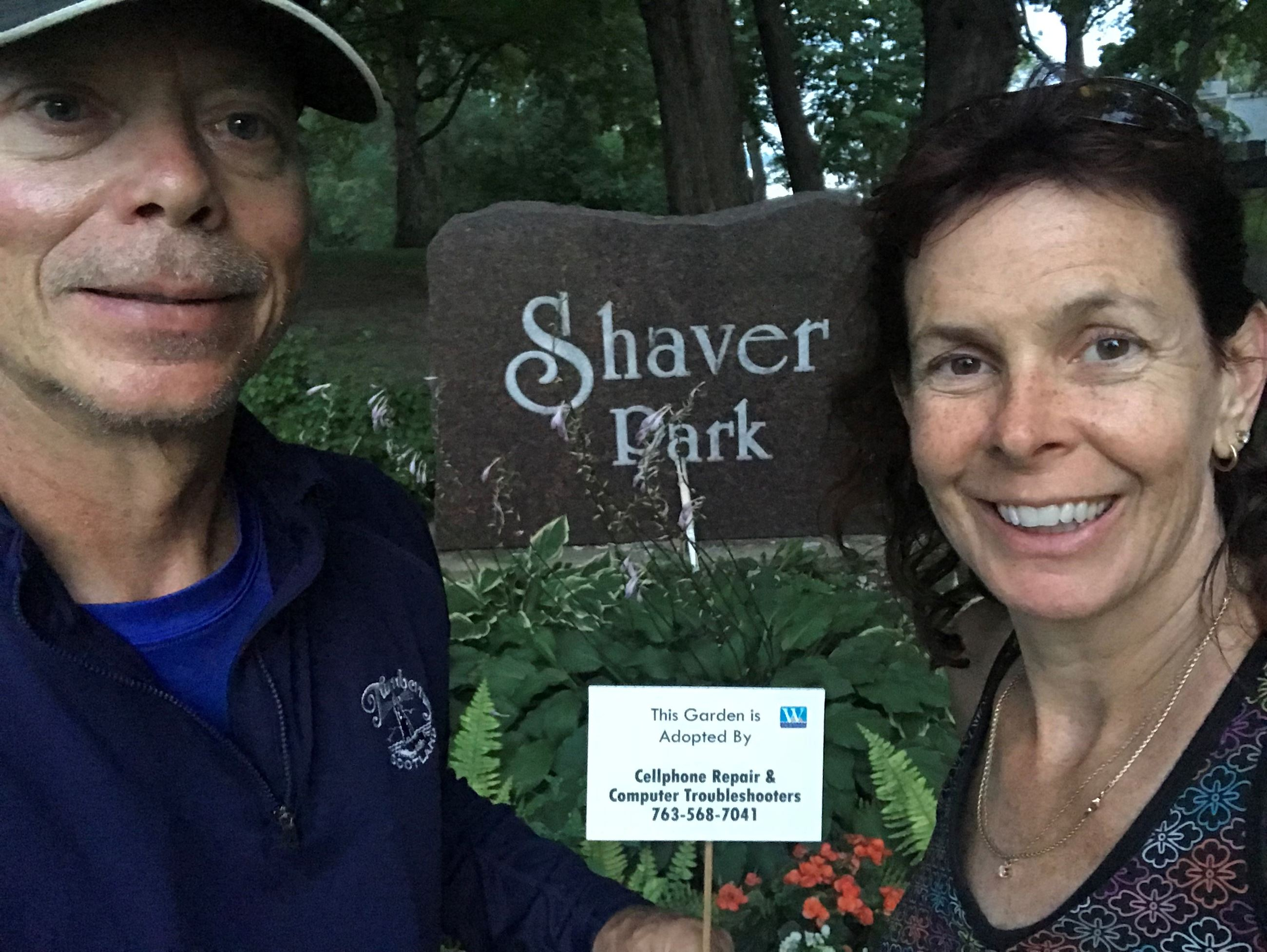 Man and woman in front of Shaver Park sign